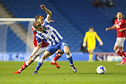 Brighton striker, Solomon March (20) battles for the ball during the Sky Bet Championship match between Brighton and Hove Albion and Bristol City at the American Express Community Stadium, Brighton and Hove, England on 20 October 2015. Photo by Phil Duncan.