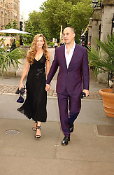 Actress NATASCHA McELHONE and her husband DR MARTIN KELLY at a summer party held at The Natural History Museum entitled 'Evolution'  on 29tth June 2004.