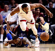 Los Angeles Clippers Sindarius Thornwell, back, falls as Miami Heats Wayne Ellington chases down for a loose ball during an NBA game in Los Angeles on Nov. 4, 2017.