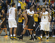 Dec 19, 2013; Long Beach, CA, USA; Long Beach State players Tyler Lamb (1), Daniel Samuels (center) and Mike Caffey (5) celebrate at the end of the game as Southern California Trojans guard Byron Wesley (22) reacts at Walter Pyramid. Long Beach State defeated USC 72-71.
