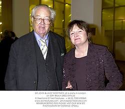 SIR JOHN & LADY MORTIMER, at a party in London on 20th March 2002.OYN 24