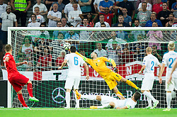 Jack Wilshere of England scores against Samir Handanovic of Slovenia first goal for England during the EURO 2016 Qualifier Group E match between Slovenia and England at SRC Stozice on June 14, 2015 in Ljubljana, Slovenia. Photo by Vid Ponikvar / Sportida