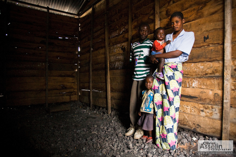 "Kobenda Walemba, his wife Emerance Masca, and their two children stand in an empty room of the small house they rent for $10 a month in Goma, Eastern Democratic Republic of Congo on Monday December 15, 2008. The couple has been in Goma for three weeks, which they reached after walking for 9 hours after violence broke out in Kiwanja, where they lived. ""We saw that if we went to stay in the camp, we would get diarrhea, we would get sick, because of all the people who stay there,"" explains Walemba. ""We had a little bit of money so we found this house. We don't sleep well, we have no food. To find water to drink is a problem. I hope our children can have a good life."""