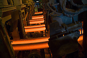 Steel  I-Beams being made from scrap iron at Profilarbed, S.A. Steel Mill in Luxembourg. Makes steel from scrap metal with an electric furnace. Profilarbed is now part of the Groupe Arcelor.
