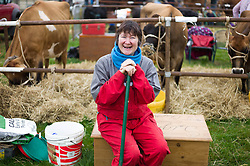 © Licensed to London News Pictures. <br /> 20/09/2014. <br /> <br /> Stokesley, England<br /> <br /> Andrea Chapman from Easby Grange takes a break from looking after her cows during the Stokesley Agricultural Show in North Yorkshire, England. The show which dates back to 1859 is the largest one day agricultural show in the north of England.<br /> <br /> Photo credit : Ian Forsyth/LNP