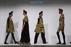 © Licensed to London News Pictures. 30/05/2015. London, UK. A model walks the runway during the Liverpool John Moores University fashion show at Graduate Fashion Week 2015 wearing the collection of graduate student Sarah Tidy. Graduate Fashion Week takes place from 30 May to 2 June 2015 at the Old Truman Brewery, Brick Lane. Photo credit : Bettina Strenske/LNP