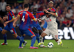 Crystal Palace's Mamadou Sakho brings down Liverpool's Mohamed Salah in the area to concede a penalty during the Premier League match at Selhurst Park, London.