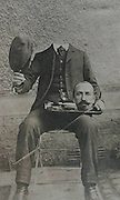 How the Victorians beat the internet to beheading craze by 100 years: Bizarre pictures show 19th Century 'photoshopping'<br /> <br /> It's not quite as subtle as the airbrushing we're used to seeing in certain celebrity magazines.<br /> But these amusing pictures show how the Victorians were the first to manipulate photographs to create some rather bizarre images.<br /> Photographers at the time combined images from more than one negative to create the novelty photographs which caused a sensation when they were first published.<br /> In one, what looks like a decapitated man sits in a chair with his head on a plate.<br /> Another image shows a man holding his wife's head as she stands beside him.<br /> <br /> A Victorian gentleman stands upright with a cane and his head tucked into his body.<br /> There is also a snap of a woman who appears to have completely lost her head with it nowhere to be seen in the picture.<br /> <br /> Similarly a man holds his head under his arm in another eerie shot.<br /> Photo manipulation became something of a craze in the Victorian era. Other common images showed people appearing to float in midair unaided.<br /> They also cleverly worked out how to make people look like giants or dwarfs.<br /> ©exclusivepix