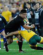 Kevin Mealamu trys to bust the tackle, Rugby Championship. Australia v All Blacks at ANZ Stadium, Sydney, New Zealand. Saturday 18 August 2012. New Zealand. Photo: Richard Hood/photosport.co.nz