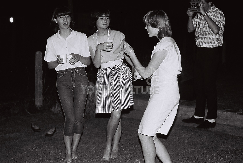 Teenagers dancing at a garden party, West London, UK, 1983