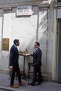 Two businessmen enjoy an informal lunchtime meal outside a City of London bar in Milford Lane, WC2.