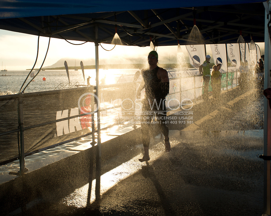 Ironman 70.3 Cairns Age Group Competitors Run Through The Showers At The Swim Exit. 2012 Ironman Cairns Triathlon. Cairns, Queensland, Australia. 03/06/2012. Photo By Lucas Wroe.
