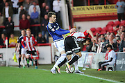 Cardiff City defender, Scott Malone (28) bundling Brentford striker, Lasse Vibe (21) off the ball during the Sky Bet Championship match between Brentford and Cardiff City at Griffin Park, London, England on 19 April 2016. Photo by Matthew Redman.