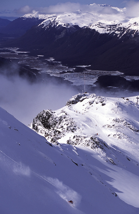 A snowboarder gets first tracks on the upper slopes of Cerro Castor ski station. Tierra Del fuego