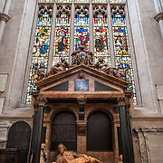 A crypt at Bath Abbey below an ornate stained glass window. Bath Abbey (formally the Abbey Church of Saint Peter and Saint Paul) is an Anglican cathedral in Bath, Somerset, England. It was founded in the 7th century and rebuilt in the 12th and 16th centuries.