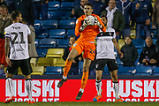 Bristol City goalkeeper Max O'Leary (24) saves the ball mid-air during the EFL Sky Bet Championship match between Millwall and Bristol City at The Den, London, England on 30 April 2019.
