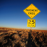 010813  Adron Gardner/Independent<br /> <br /> A sign denotes the unpaved start of Navajo Route 71 at the junction with Navajo Route 2 near Winslow Leupp Flagstaff Wednesday.
