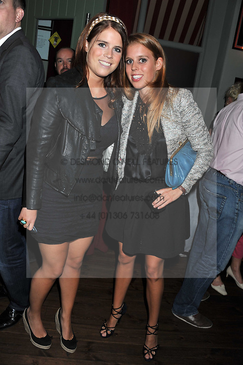 Left to right, PRINCESS EUGENIE OF YORK and PRINCESS BEATRICE OF YORK at a party to celebrate the opening of Bunga Bunga - a new Pizzeria & Bar, 37 Battersea Bridge Road, London SW11 on 1st September 2011.