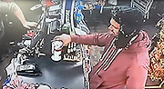 shameless Hove charity box theft suspect<br /> <br /> This shocking footage shows the moment a thief shamelessly snatches two charity boxes and a man's wallet from a shop counter in Hove.<br /> <br /> The incident was caught on camera at Vega Express, in Sackville Road, at about 7.26pm on Saturday 10 September.<br /> ©Exclusivepix Media