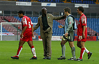 Photo: Paul Thomas.<br /> Huddersfield Town v Swindon Town. Coca Cola League 1. 29/10/2005. <br /> <br /> Swindon manager Iffy Onuora congratulates his players after their 1 all draw with Huddersfield.