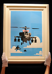 © Licensed to London News Pictures. 23/03/2012. London, UK. Banksy (b. 1975) Happy Choppers Estimate: £4,000 - 6,000, A photocall of Bonham's Urban Art Sale including Seventeen art works by the celebrated graffiti artist, Banksy, which are to be sold at Bonhams, London, ahead of the Urban Art Sale, which takes place on 29 March 2012. . Photo credit : Stephen SImpson/LNP