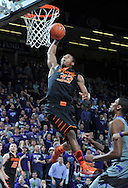 MANHATTAN, KS - JANUARY 05:  Guard Marcus Smart #33 of the Oklahoma State Cowboys drives in for a basket against the Kansas State Wildcats during the first half on January 5, 2013 at Bramlage Coliseum in Manhattan, Kansas.  (Photo by Peter G. Aiken/Getty Images) *** Local Caption *** Marcus Smart