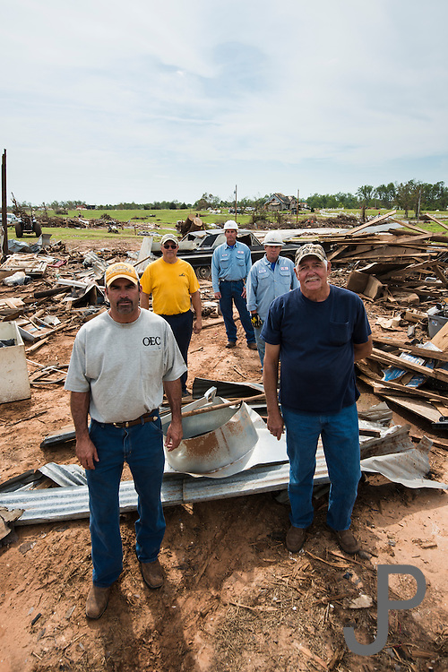 Cover shoot for Oklahoma Living Magazine about Moore tornado victims at 149th & Penn and how OEC helped them