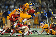 Tupelo's Jarvis Wilson (7) is tackled by Lafayette High's Eli Murphree (2) in Oxford, Miss. on Friday, August 22, 2014. Tupelo won the season opener 20-0.