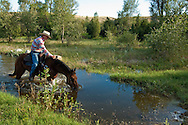 Trail Rider crosses water, Montana, <br />