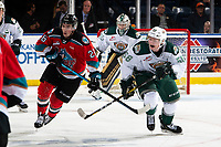 KELOWNA, BC - SEPTEMBER 28:  Liam Kindree #26 of the Kelowna Rockets stick checks Jack Lambert #58 of the Everett Silvertips during third period at Prospera Place on September 28, 2019 in Kelowna, Canada. (Photo by Marissa Baecker/Shoot the Breeze)
