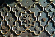 The Taj Mahal mausoleum geometric pattern detail of repousse on heavy bronze door, Uttar Pradesh, India