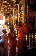 Monks stand by the main shrine at the Dalada Maligawa, Temple of the Tooth, in Kandy. Waiting to see the Tooth Relic which was on exposition at the time. April 2004