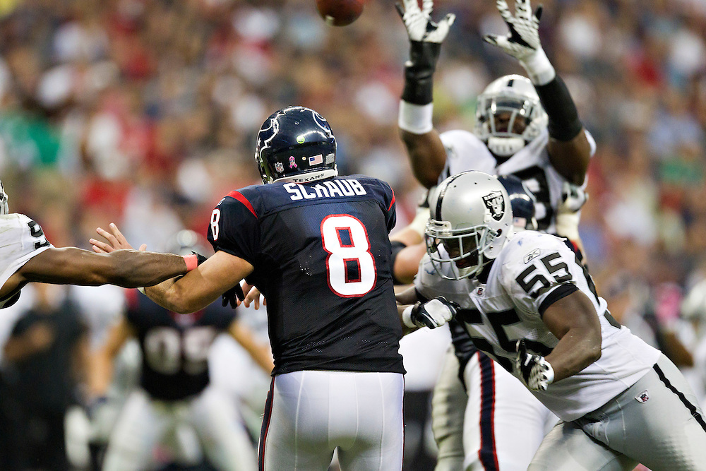 HOUSTON, TX - OCTOBER 9:   Matt Schaub #8 of the Houston Texans throws a pass under pressure from Rolando McClain #55 of the Oakland Raiders at Reliant Stadium on October 9, 2011 in Houston, Texas.  The Raiders defeated the Texans 25 to 20.  (Photo by Wesley Hitt/Getty Images) *** Local Caption ***Matt Schaub; Rolando McClain