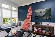 A mud room designed by Melanie Roy Design in the Hampton Designer Showhouse on Paul's Lane Bridgehampton, July 11, 2014.  Themed for beach and surfing this room includes surf boards by Barry McGee a San Francisco artist and the painting by John Margaritis is entitled Southampton Wave.   ©  Audrey C. Tiernan