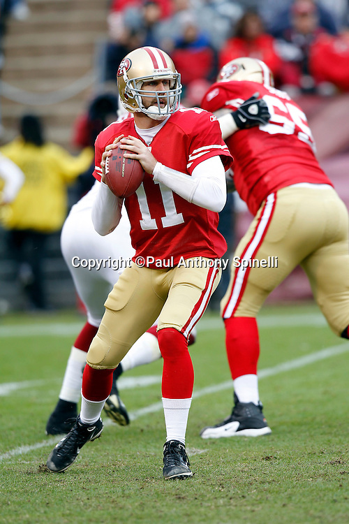 San Francisco 49ers quarterback Alex Smith (11) drops back to throw a pass during the NFL week 17 football game against the Arizona Cardinals on Sunday, January 2, 2011 in San Francisco, California. The 49ers won the game 38-7. (©Paul Anthony Spinelli)