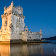 LISBON, Portugal -- Built on a small island near the banks of the Tagus River just to the southwest of downtown Lisbon, the Tower of Belem (or Torre de Belém) dates to 1514-1520. It was part of a defensive network protecting shipping to Lisbon port and beyond during Portugal's Age of Discovery. Paired with the nearby Jerónimos Monastery it is listed as a UNESCO World Heritage Site. The light in the sky at right is the light trail of a plane coming in to land at Lisbon International Airport.