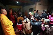 QUANZHOU, CHINA - JANUARY 10: (CHINA OUT) <br /> <br /> Believers come to respect monk Fuhou\'s body which was found not rotted after putting in a vat for three and a half years at Puzhao temple on Zimao Mountain on January 10, 2016 in Quanzhou, Fujian Province of China. 94-year-old monk Fuhou died in 2012 and his body was put by the sitting position into a vat with a cover for three and a half years. Monks found that Fuhou\'s body wasn\'t rotted on an opening vat rite on January 10 at Puzhao temple on Zimao Mountain in Quanzhou. The body would be cleaned and stuck with gold to be made into a golden Buddha.<br /> ©Exclusivepix Media