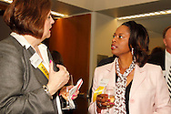 Nancy Husson of the Wright-Patt Credit Union (left) and Shanda McKinney of the Wright-Patt Credit Union .during the Better Business Bureau's Eclipse Integrity Awards dinner at the Ponitz Center at Sinclair Community College in downtown Dayton, Tuesday, May 8, 2012.