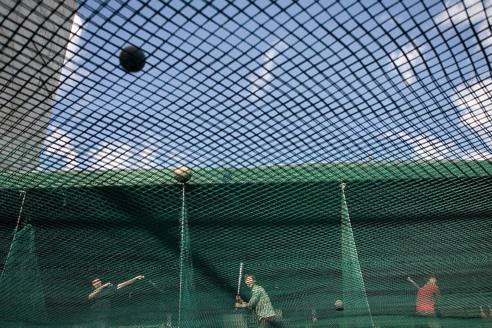 South Korea, Seoul,  Baseball batting cafe along Insadong Market on spring afternoon
