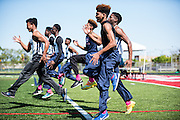 The Johnson College Prep boys track team wears pink socks during a track meet at St. Rita High School on May 19, 2016 to honor classmate De'Kayla Dansberry who was fatally stabbed.