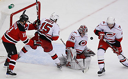 Apr 23, 2009; Newark, NJ, USA; New Jersey Devils center John Madden (11) and Carolina Hurricanes right wing Tuomo Ruutu (15) battle for the loose puck after a save by Carolina Hurricanes goalie Cam Ward (30) during the first period of game five of the eastern conference quarterfinals of the 2009 Stanley Cup playoffs at the Prudential Center.