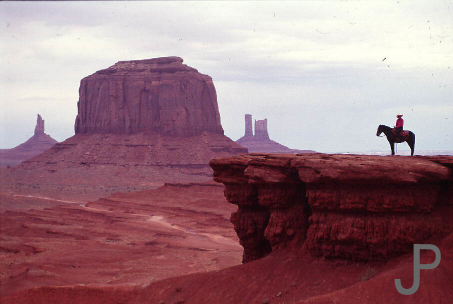 Indian on horse in front of Monument Valley, UT