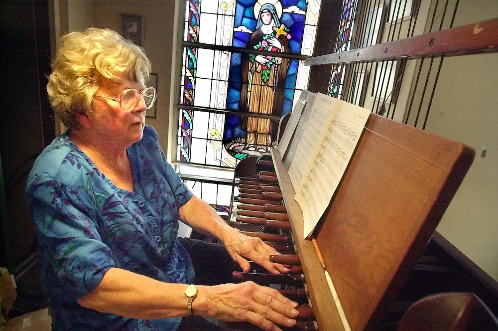 Gloucester: .Marilyn Clark, of Rockport, practices on the carillon at Our Lady of Good Voyage Church Wednesday, June 30. This year's Summer Carillon Recitals will feature Clark on July 6, Dennis Curry July 13, Jim Smith July 20 and Justin Ryan July 27. All recitals will be at 7 p.m. at the church..Photo by Mike Dean/Gloucester Daily Times. Wednesday, June 30, 2004