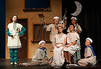 """Pseudolus (Heather Hunt), Philia (Kaylee Lemire) and Hero (Jack Harding) are surrounded by The Proteans Kylieh Farley, Anna Malek, Andrew Fielders and Delaney Andrews during dress rehearsal for """"A Funny Thing Happened on the Way to the Forum"""" at Gilford High School Tuesday evening.  (Karen Bobotas/for the Laconia Daily Sun)"""