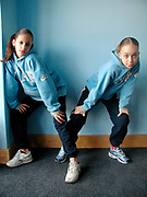 Two girls wearing matching Gap jumpers