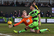 Forest Green Rovers Christian Doidge(9) shoots at goal Notts County goalkeeper Ryan Schofield(27) makes a save during the EFL Sky Bet League 2 match between Forest Green Rovers and Notts County at the New Lawn, Forest Green, United Kingdom on 9 February 2019.