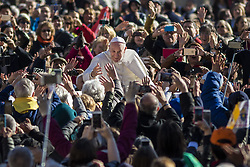 November 9, 2016 - Vatican City, Vatican - Pope Francis rides on the Popemobile through the crowd of the faithful as he arrives to celebrate his Weekly General Audience in St. Peter's Square in Vatican City, Vatican on November 09, 2016. Pope Francis on Wednesday urged the faithful not to fall into indifference but to become active instruments of mercy. (Credit Image: © Giuseppe Ciccia/Pacific Press via ZUMA Wire)