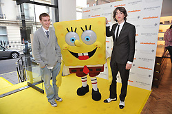 Left to right, CHASE ROBERTS, SpongeBob SquarePants and SASCHA BAILEY at a party to launch a range of SpongeBob SquarePants suits and accessories designed by Richard James in partnership with Nickelodeon held at Richard James, 29 Savile Row, London W1 on 11th May 2011.