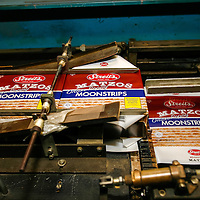 Streit's Matzoh, NYC. Matzoh in plain boxes is loaded onto a machine that will affix the wrapper to the package.