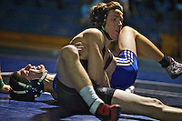 Coeur d'Alene High's Steve Price gives a grimace of pain as Post Falls High's Mitch Crain applies pressure to his arm and shoulder in the 120-pound match Crain won by decision Thursday.